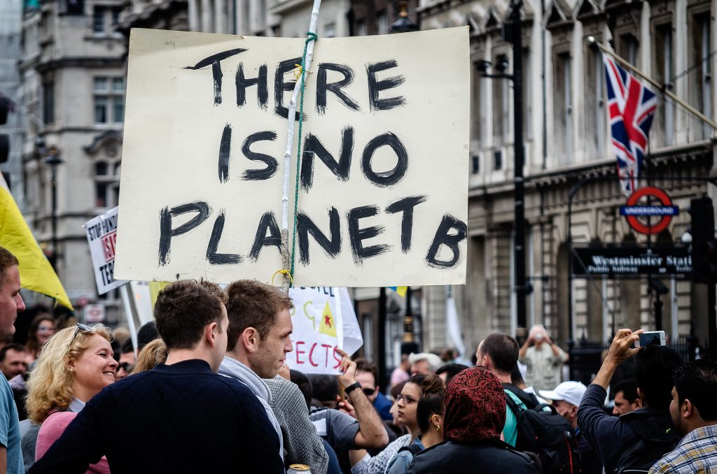 "Placard reads ""There is no planet B"""