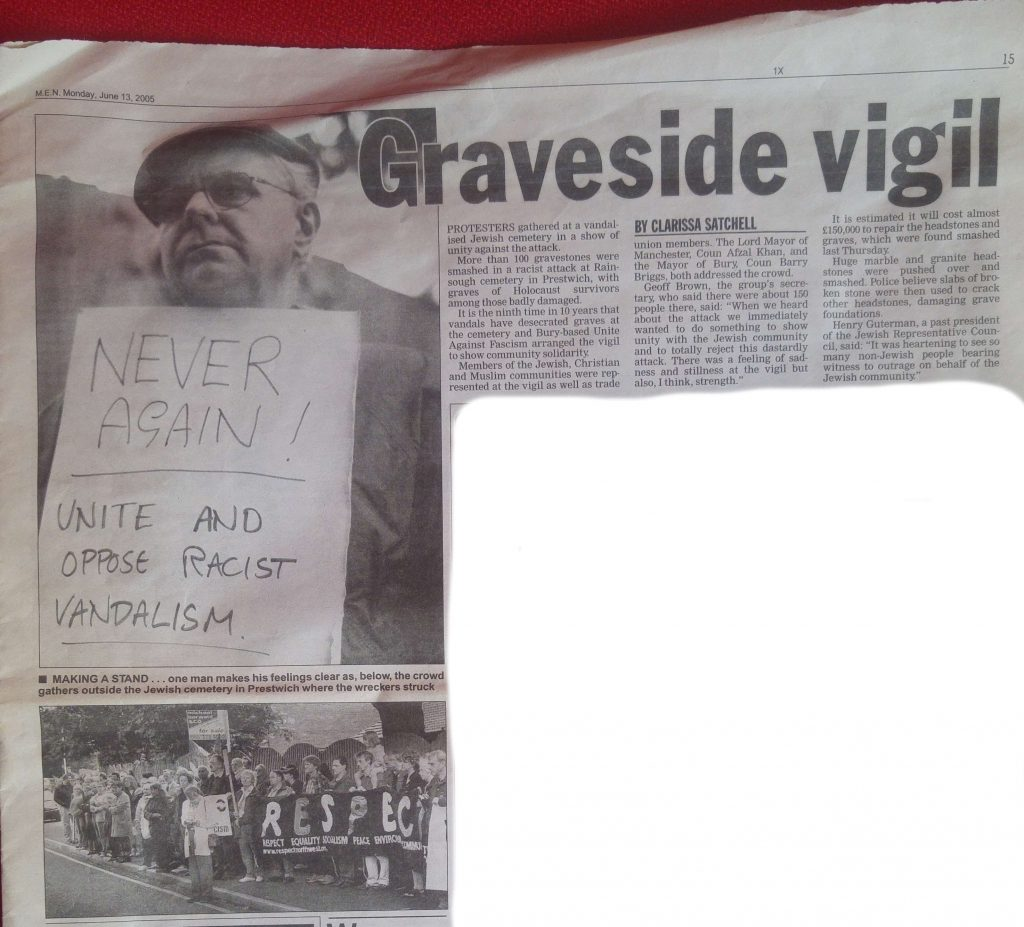 "Bartley in Manchester Evening News holding placard ""never again"", graveside vigil at Jewish cemetary"