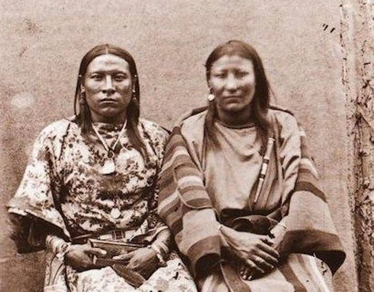 "Osh Tisch (left) of the Crow nation with their wife. The name means ""finds them and kills them"""
